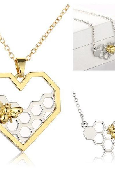 Gold bee and honeycomb pendant necklace